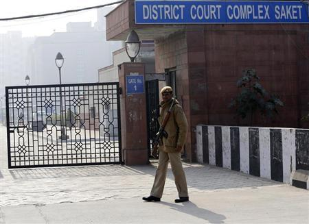 A policeman keeps guard outside a court in New Delhi
