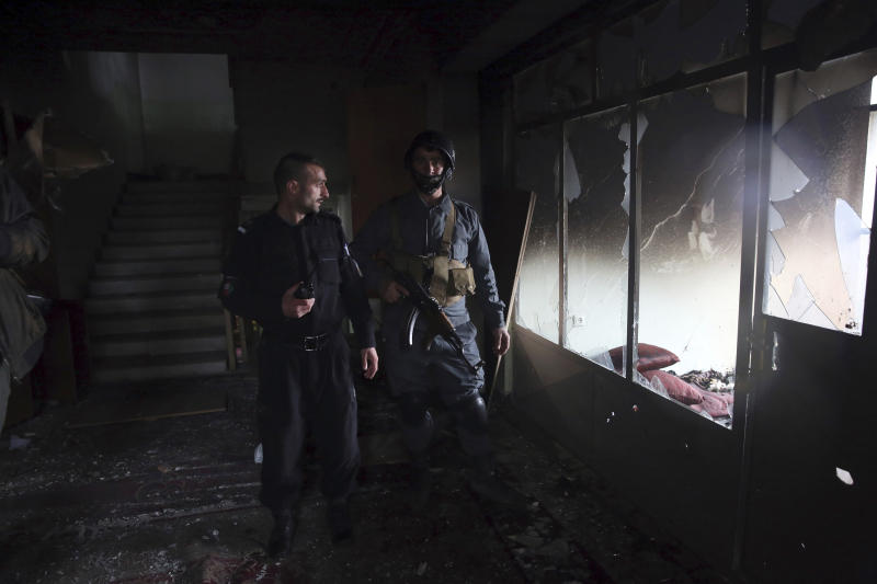 Afghan security personnel inspect a Sikh house of worship, in the aftermath of a deadly attack in Kabul, Afghanistan, Wednesday, March 25, 2020. The Interior Ministry said a lone Islamic State gunman rampaged through the Sikh place of worship, called Gurdwara, in the heart of the Afghan capital on Wednesday, killing over 20 worshippers and wounding others. It said that the gunman held many of the worshippers hostage for several hours as Afghan special forces, helped by international troops, tried to clear the building. (AP Photo/Rahmat Gul)