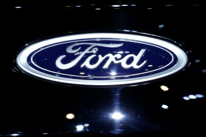 FILE PHOTO: A logo of Ford is pictured on a car at an event in Switzerland