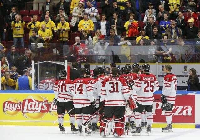 Canada's players leave the ice following their loss to Russia in their IIHF World Junior Championship bronze medal ice hockey game in Malmo, Sweden, January 5, 2014. REUTERS/Alexander Demianchuk (SWEDEN - Tags: SPORT ICE HOCKEY)