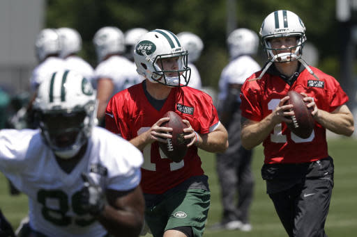 New York Jets quarterbacks Sam Darnold, center, and Josh McCown, right, throw during the NFL football team's training camp, Tuesday, June 12, 2018, in Florham Park, N.J. (AP Photo/Mark Lennihan)