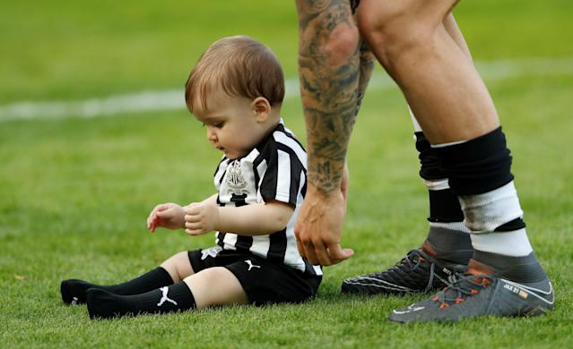 "Soccer Football - Premier League - Newcastle United vs Chelsea - St James' Park, Newcastle, Britain - May 13, 2018 Newcastle United's Joselu with child on the pitch at the end of the match Action Images via Reuters/Lee Smith EDITORIAL USE ONLY. No use with unauthorized audio, video, data, fixture lists, club/league logos or ""live"" services. Online in-match use limited to 75 images, no video emulation. No use in betting, games or single club/league/player publications. Please contact your account representative for further details."