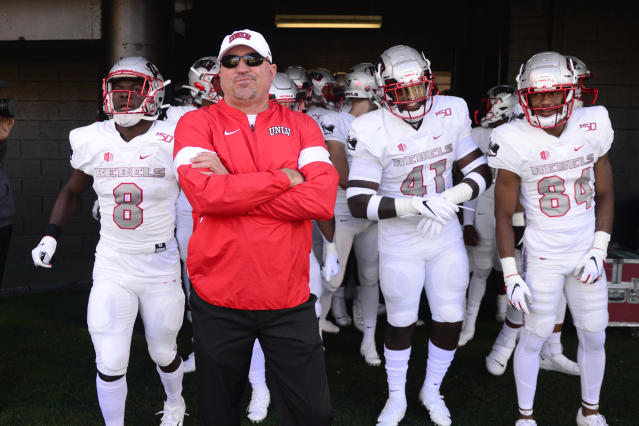 UNLV Head Coach Tony Sanchez prepares to lead his team onto the field against Vanderbilt before an NCAA college football game Saturday, Oct. 12, 2019, in Nashville, Tenn. (AP Photo/Mike Strasinger)