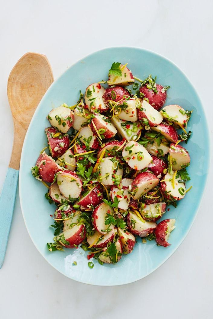 """<p>Chimichurri is not just for beef. Drizzle it over a potato salad to add another dimension of taste to an otherwise plain side dish.</p><p><a href=""""https://www.womansday.com/food-recipes/food-drinks/recipes/a12530/chimichurri-potato-salad-recipe-wdy0614/"""" rel=""""nofollow noopener"""" target=""""_blank"""" data-ylk=""""slk:Get the recipe for Chimichurri Potato Salad."""" class=""""link rapid-noclick-resp""""><em>Get the recipe for Chimichurri Potato Salad</em>.</a></p>"""