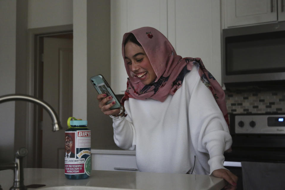 Amirah Ahmed, 17, video chats with a friend from her home in Fredericksburg, Va., on Saturday, Aug. 14, 2021. (AP Photo/Jessie Wardarski)