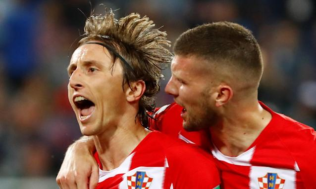 Luka Modric celebrates with Ante Rebic after scoring Croatia's second goal from the penalty spot.