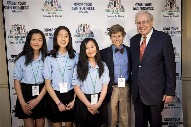 Graylin, Chua, Graylin and Johnson stand with Buffett at the Marriott Hotel in Omaha