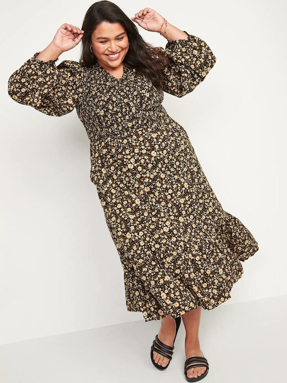 <p>This <span>Old Navy Long-Sleeve Fit and Flare Smocked Midi Dress</span> ($55) with boots or booties would be pair well with fall and winter date nights. Finish off the look with a trench coat or a long leather jacket.</p>