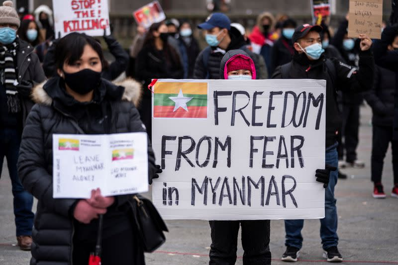 People attend a protest against the military coup in Myanmar, at Town Hall Square in Copenhagen