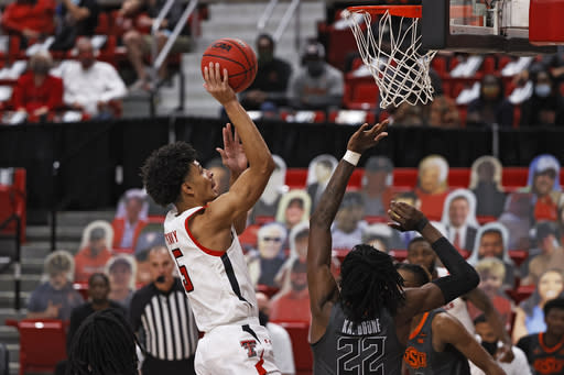 Texas Tech's Micah Peavy (5) shoots over Oklahoma State's Kalib Boone (22) during the first half of an NCAA college basketball game Saturday, Jan. 2, 2021, in Lubbock, Texas. (AP Photo/Brad Tollefson)