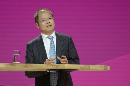 FILE PHOTO: Eric Xu, CEO of Huawei addresses media at Cebit fair in Hanover