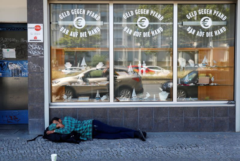FILE PHOTO: Homeless man is pictured in front of a pawnshop in Berlin