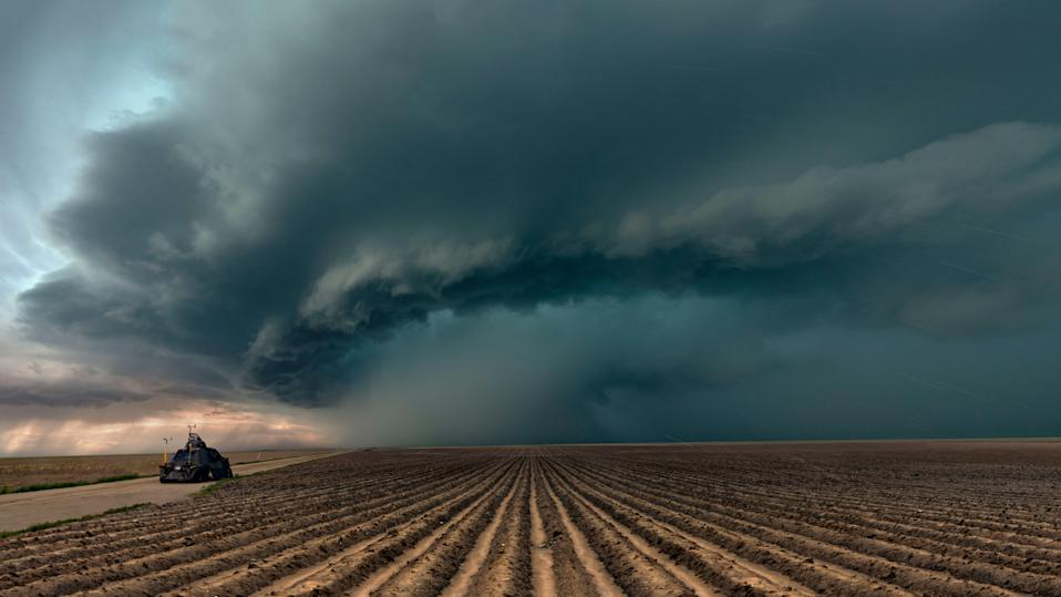 Extreme weather in tornado alley with the famous Tornado Intercept Vehicle. these vehicles are designed to cope with the dangerous winds and debris of tornadoes, up to EF3 strength. Seen here with a severe thunderstorm moving across farmland in  Colorado with hailstones falling.