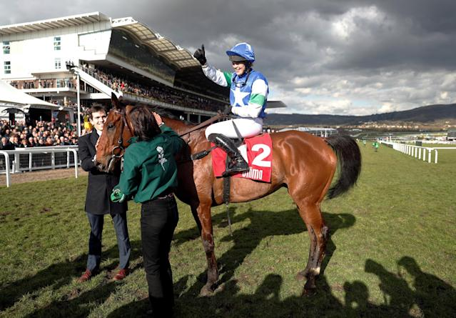 Horse Racing - Cheltenham Festival - Cheltenham Racecourse, Cheltenham, Britain - March 13, 2018 Lizzie Kelly celebrates on Coo Star Sivola after winning the 14:50 Ultima Handicap Chase Action Images via Reuters/Matthew Childs