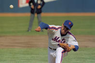 FILE - In this April 5, 1983, file photo, New York Mets pitcher Tom Seaver throws against the Philadelphia Phillies during an Opening Day baseball game at Shea Stadium in New York. To baseball fans, opening day is an annual rite of springthat evokes great anticipation and warm memories. This year's season was scheduled to begin Thursday, March 26, 2020, but there will be no games for a while because of the coronavirus outbreak. (AP Photo/Richard Drew, File)