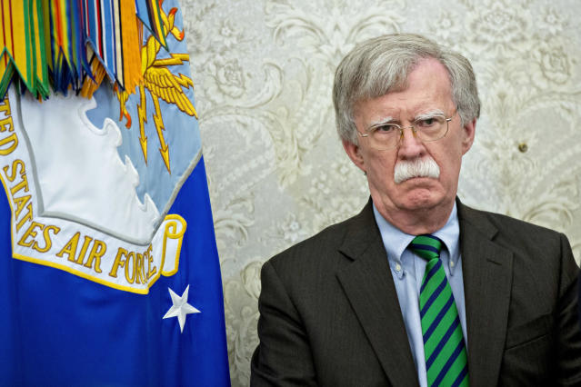 Picture the scene: John Bolton stands proudly against a backdrop of an