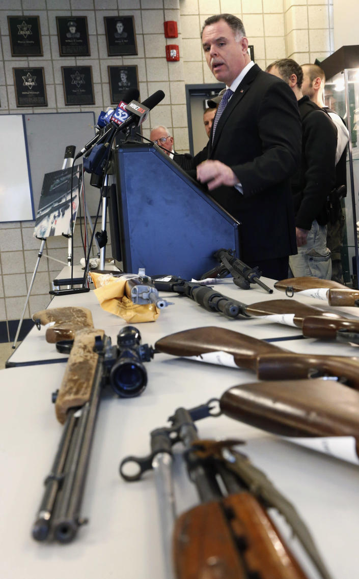 """In this Feb. 26, 2013 file photo, Chicago Police Superintendent Garry McCarthy stands near guns confiscated in Chicago and talks about the department's efforts to curb gun violence during a news conference in Chicago. As Illinois Gov. Pat Quinn mulls whether to sign off on eliminating the nation's last ban on public possession of guns, the question in Chicago is whether it will matter in the crime-weary city where a spiking murder rate drew national attention last year. McCarthy calls a requirement that people go through only 16 hours of training before they are issued a concealed carry permit """"Incredibly troubling."""" (AP Photo/Charles Rex Arbogast, File)"""