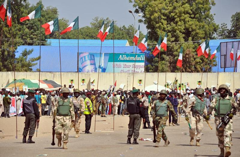 Soldiers and policemen deploy to secure the venue during a rally of the ruling People's Democratic Party (PDP) in Maiduguri, northeast Nigeria on January 24, 2015