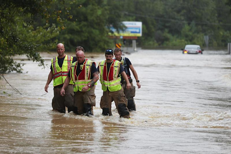 Firefighters wade through a flooded road after Hurricane Sally passed through Pensacola, Florida: Getty Images
