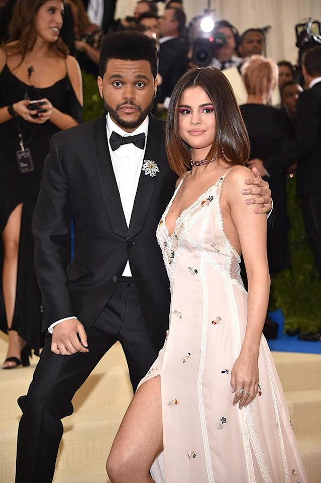 """<p>After 10 months of dating, the superstars <a href=""""https://www.yahoo.com/entertainment/selena-gomez-weeknd-split-10-months-together-185522250.html"""" data-ylk=""""slk:ended their relationship;outcm:mb_qualified_link;_E:mb_qualified_link"""" class=""""link rapid-noclick-resp"""">ended their relationship</a> this fall. The """"Starboy"""" crooner and Gomez were said to have split on amicable terms, with crazy schedules being to blame. The """"Wolves"""" singer's calendar must jive much better with Justin Bieber's, because the pair quickly reconnected and are back together. (Photo: Kevin Mazur/WireImage) </p>"""