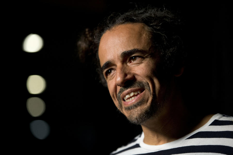 """Ruben Albarran of Mexican rock band Cafe Tacuba speaks during an interview in Mexico City, Monday, April 18, 2016. Cafe Tacuba will be the Latin headliner in this year's massive Vive Latino festival and plan to mark the 20th anniversary of their album """"Avalancha de exitos"""" by performing it from beginning to end. (AP Photo/Rebecca Blackwell)"""
