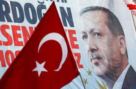 A huge banner with a picture of Turkish President Tayyip Erdogan is seen on a building during a ceremony in Istanbul