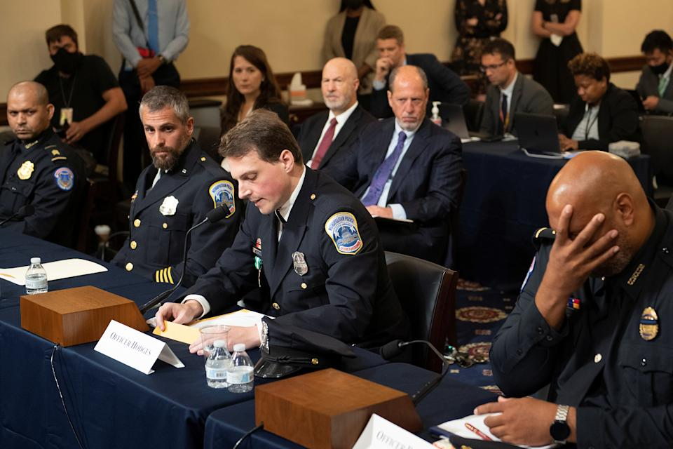 Aquilino Gonell, sergeant of the U.S. Capitol Police, Michael Fanone, officer for the Metropolitan Police Department, and Harry Dunn, private first class of the U.S. Capitol Police, listen while Daniel Hodges, officer for the Metropolitan Police Department, testifies during a hearing of the House select committee investigating the Jan. 6 attack on Capitol Hill in Washington, U.S., July 27, 2021. (Brendan Smialowski/Pool via Reuters)