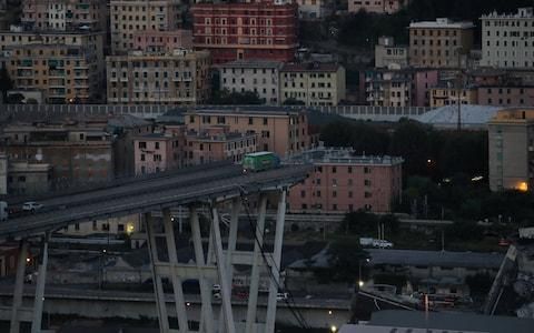A truck is seen at the collapsed Morandi Bridge site in the port city of Genoa, Italy  - Credit: Reuters