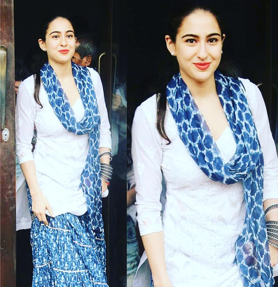 <p>The indigo prints, or the block prints in blue on the pure cotton fabric has gained a lot of popularity lately. While we are wearing them on <em>kurtis</em> and sarees, Sara Ali Khan just tutored us on a whole new way of embracing the indigo. She teams up a plain <em>chikankari kurti</em> with a pair of extra flared <em>shararas</em> and a matching dupatta. A bright pop of color on the lips completes the otherwise make-up free look. </p>