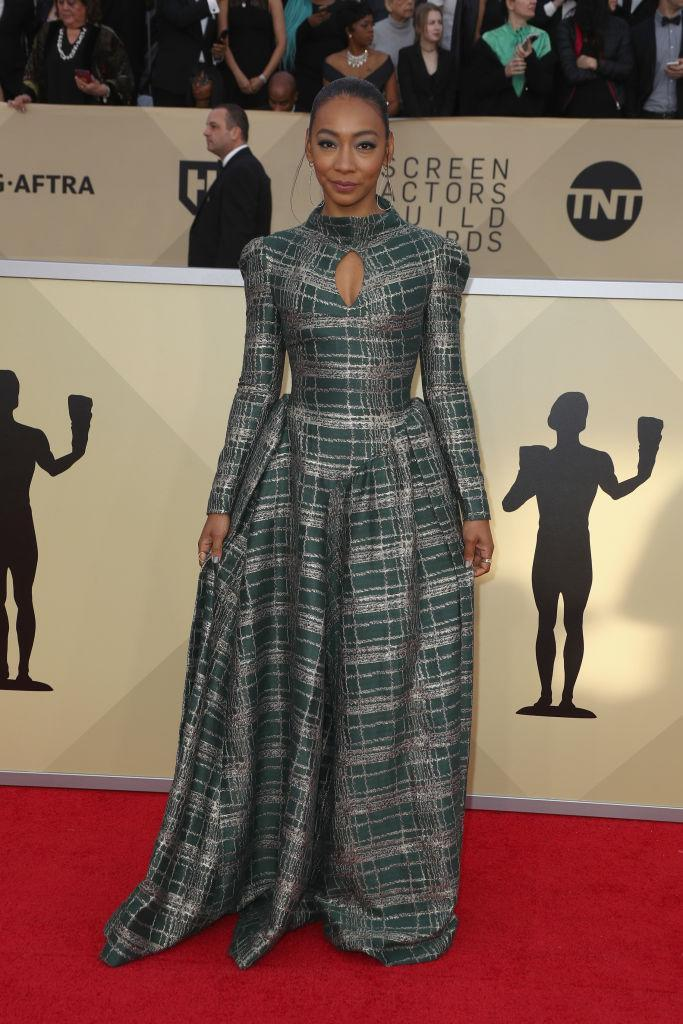 <p>Gabriel wore a green dress featuring a plaid-like pattern. (Photo: Getty Images) </p>