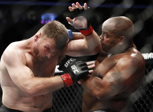 Daniel Cormier, right, fights Stipe Miocic during a heavyweight title mixed martial arts bout at UFC 226, Saturday, July 7, 2018, in Las Vegas. (AP Photo/John Locher)