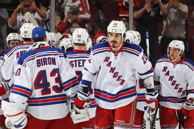 NEWARK, NJ - MAY 19:  Brian Boyle #22 of the New York Rangers and his teammates celebrate their 3 to 0 win over the New Jersey Devils in Game Three of the Eastern Conference Final during the 2012 NHL Stanley Cup Playoffs at the Prudential Center on May 19, 2012 in Newark, New Jersey.  (Photo by Bruce Bennett/Getty Images)
