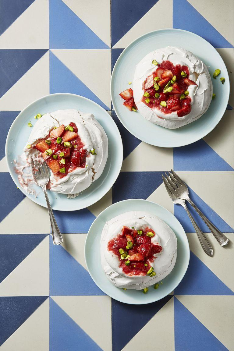 "<p>Fruity compote and salty pistachios balance out the sweetness of the meringue.</p><p><em><a href=""https://www.goodhousekeeping.com/food-recipes/dessert/a19865874/meringues-with-strawberry-rhubarb-compote-recipe/"" rel=""nofollow noopener"" target=""_blank"" data-ylk=""slk:Get the recipe for Meringues with Strawberry-Rhubarb Compote »"" class=""link rapid-noclick-resp"">Get the recipe for Meringues with Strawberry-Rhubarb Compote »</a></em></p>"