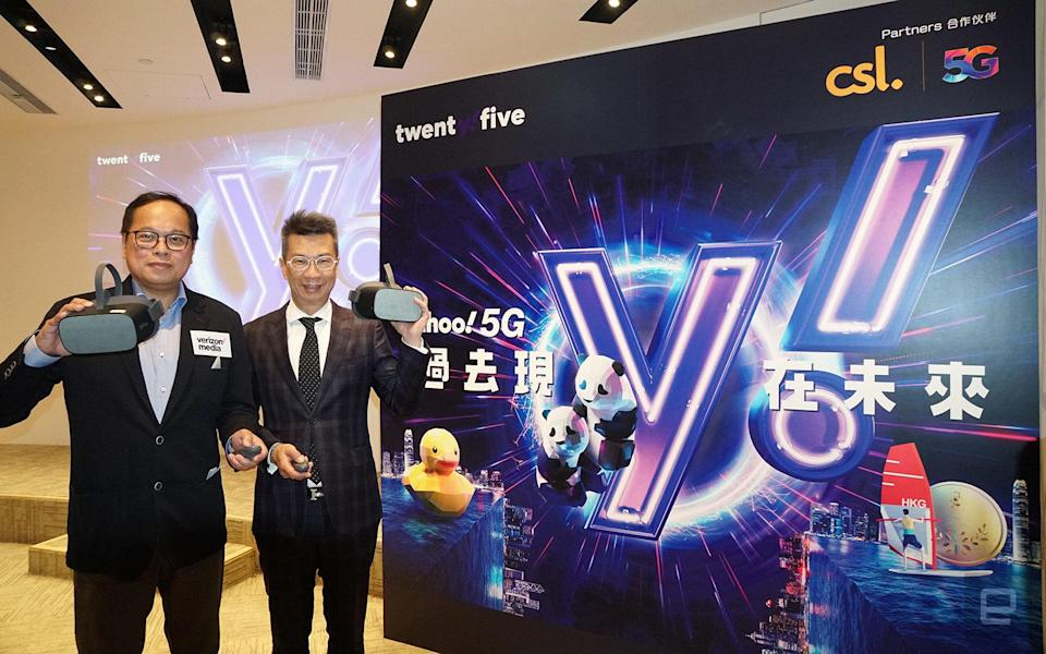Verizon Media Co-head of APAC Rico Chan and CSL Consumer Mobile Managing Director Bruce Lam launch the Yahoo 5G SIM card, which can be used to consume AR and VR content provided by both CSL and Verizon Media.