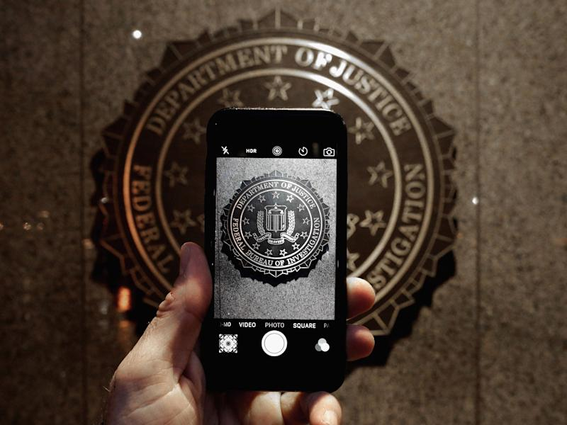 The FBI logo is seen through an iPhone camera at the bureau's headquarters in Washington, D.C: Chip Somodevilla/Getty Images