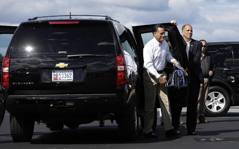 Republican presidential candidate Mitt Romney gets out of his vehicle as he boards his campaign charter plane in Bedford, Mass., Monday, Sept. 10, 2012. (AP Photo/Charles Dharapak)