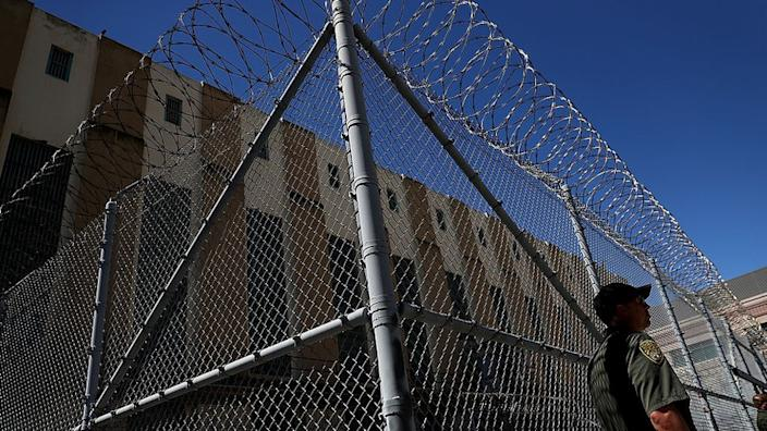An armed California Department of Corrections and Rehabilitation (CDCR) officer stands guard at San Quentin State Prison's death row on August 15, 2016 in San Quentin, California