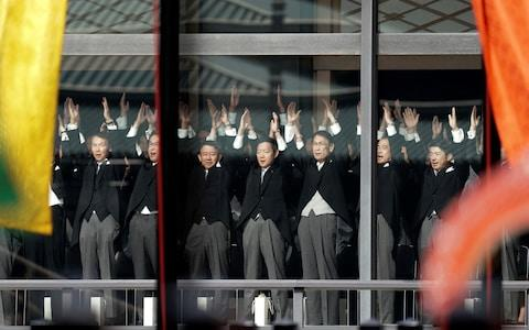 Japanese officials shout banzai cheers for the Emperor - Credit: AFP