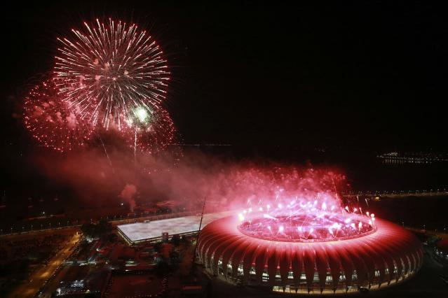 An aerial view shows fireworks over the Beira-Rio stadium during its opening ceremony in Porto Alegre April 5, 2014. The stadium will be one of the stadiums hosting the 2014 World Cup soccer matches. REUTERS/Diego Vara (BRAZIL - Tags: SPORT SOCCER WORLD CUP)