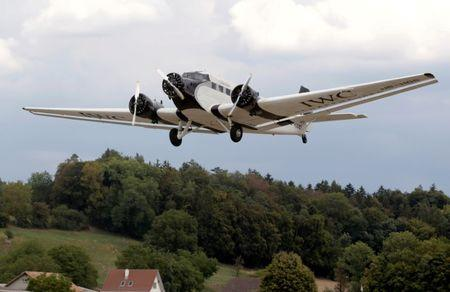 A Junkers Ju-52 airplane of JU-AIR airline takes-off from the airport in Duebendorf, Switzerland August 17, 2018.  REUTERS/Arnd Wiegmann/Files