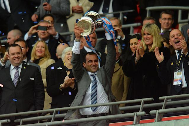 LONDON, ENGLAND - MAY 11: Manager Roberto Martinez of Wigan Athletic lifts the trophy following his team's 1-0 victory during the FA Cup with Budweiser Final between Manchester City and Wigan Athletic at Wembley Stadium on May 11, 2013 in London, England. (Photo by Shaun Botterill/Getty Images)