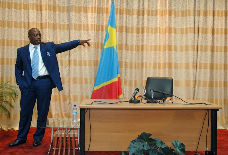"""Under a landmark accord, the country's contested president, Joseph Kabila (pictured) will stay in power until elections are held at the """"end of 2017"""" (AFP Photo/LIONEL HEALING)"""
