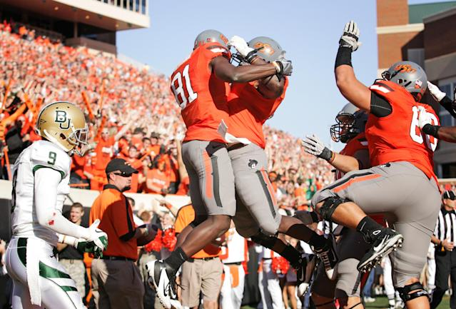 STILLWATER, OK - OCTOBER 29: Wide receiver Justin Blackmon #81 and fullback Kye Staley #9 of Oklahoma State Cowboys celebrate a touchdown in the first half against the Baylor Bears on October 29, 2011 at Boone Pickens Stadium in Stillwater, Oklahoma. Oklahoma State leads Baylor 35-0 at the half. (Photo by Brett Deering/Getty Images)