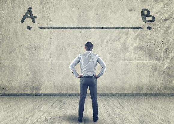 Man facing wall with line and points A and B drawn on wall