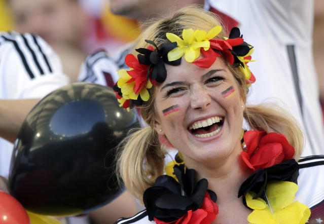 A German supporter smiles before the World Cup final soccer match between Germany and Argentina at the Maracana Stadium in Rio de Janeiro, Brazil, Sunday, July 13, 2014. (AP Photo/Matthias Schrader)