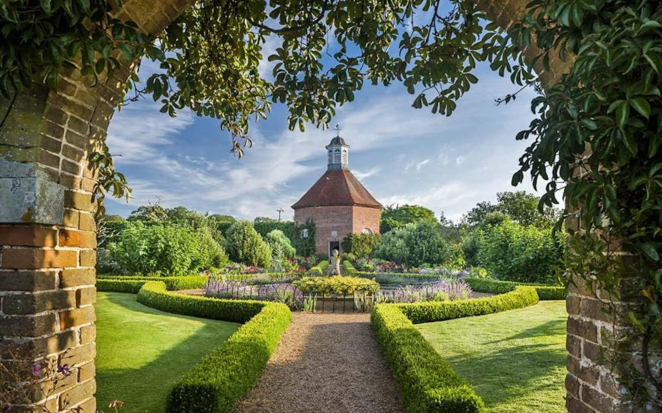 Step through the ornate brick archway into Felbrigg Gardens and you'll find a fragrant paradise - ANDREW BUTLER / NATIONAL TRUST