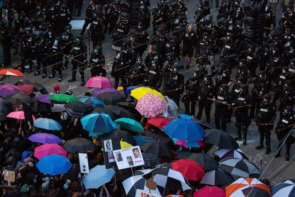 PHOTO: Demonstrators face off with law enforcement personnel on June 6, 2020, in Seattle. (David Ryder/Getty Images)