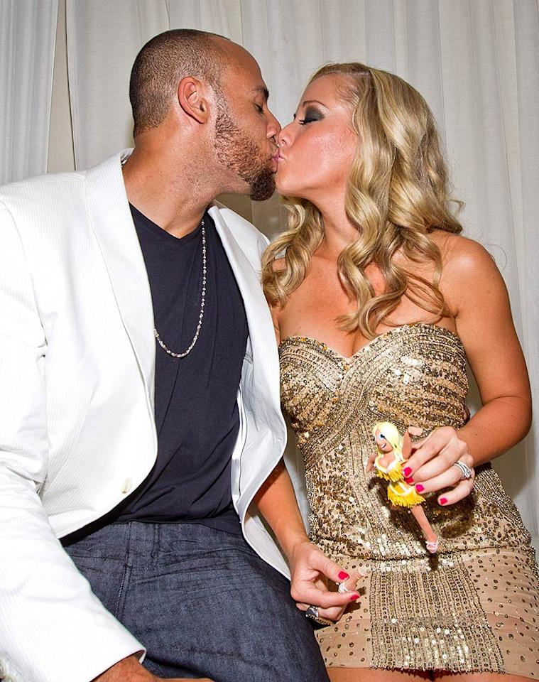 """Aww, the couple looks so in love! But with Kendra's announcement that she'll stay in Los Angeles even if Hank moves somewhere else to play football, do you think the two will stay together? <a href=""""http://www.infdaily.com"""" target=""""new"""">INFDaily.com</a> - June 11, 2011"""