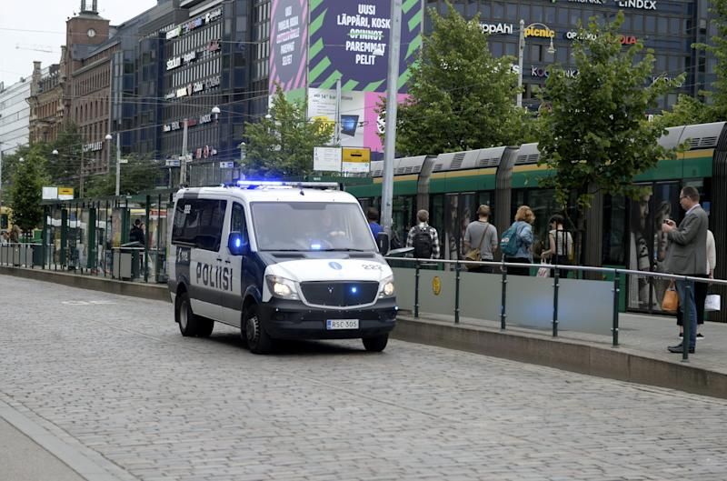 REFILE - UPDATING SLUG Finnish police patrol the streets, after stabbings in Turku, in Central Helsinki, Finland August 18, 2017. LEHTIKUVA/Linda Manner via REUTERS     ATTENTION EDITORS - THIS IMAGE WAS PROVIDED BY A THIRD PARTY. NOT FOR SALE FOR MARKETING OR ADVERTISING CAMPAIGNS. NO THIRD PARTY SALES. NOT FOR USE BY REUTERS THIRD PARTY DISTRIBUTORS. FINLAND OUT. NO COMMERCIAL OR EDITORIAL SALES IN FINLAND.