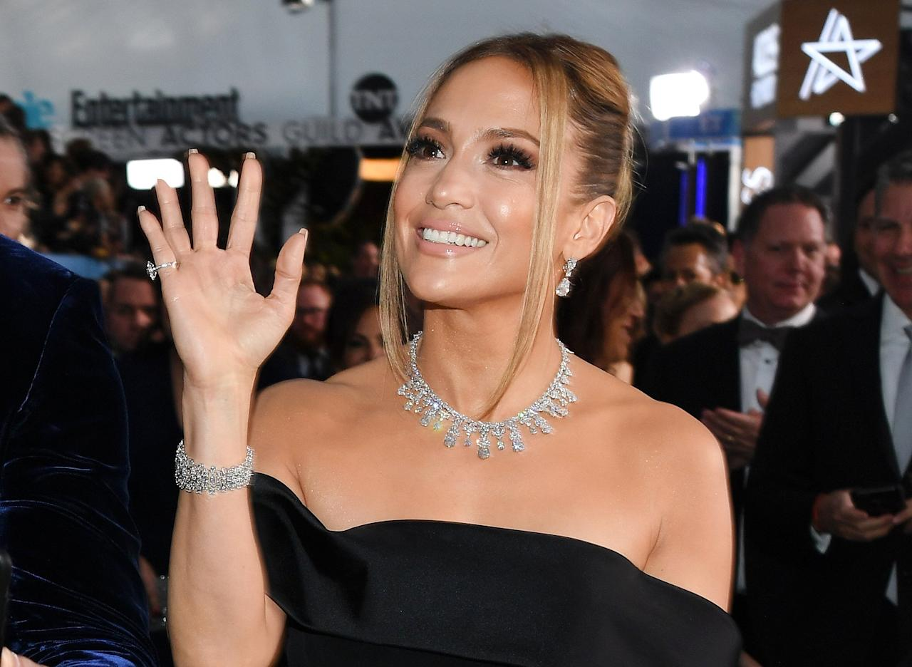 """Before the ceremony even started, JLo<a href=""""https://people.com/style/sag-awards-2020-jennifer-lopez-dress-red-carpet-photos/""""> walked the carpet as a winner wearing over $9 million worth of Harry Winston jewelry</a>, including a 73.55-carat necklace, 13.77-carat drop diamond earrings, two diamond bracelets totaling over 95 carats and two diamond rings boasting more than 17.50 carats."""